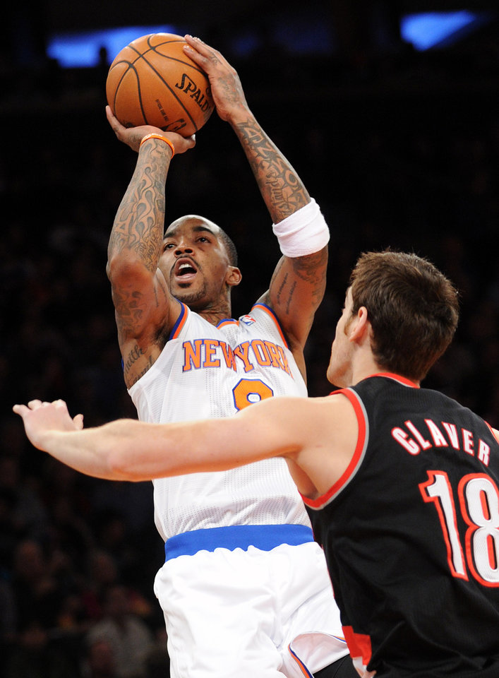 Photo - New York Knicks' J.R. Smith shoots over Portland Trail Blazers' Victor Claver (18), of Spain, during the second quarter of an NBA basketball game, Tuesday, Jan. 1, 2013, at Madison Square Garden in New York. (AP Photo/Bill Kostroun)