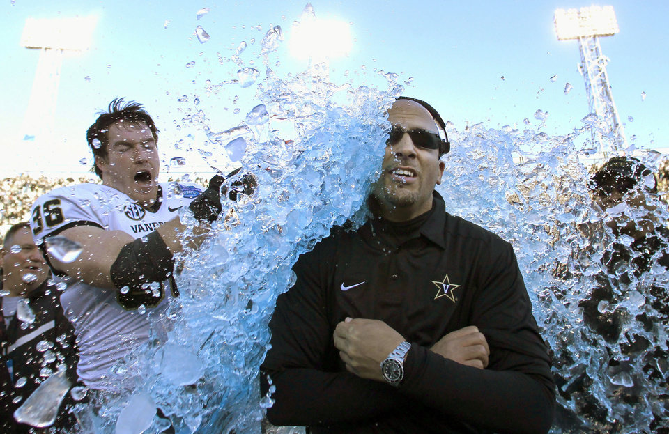 Photo - FILE - In this Saturday, Jan. 4, 2014 file photo, Vanderbilt coach James Franklin is doused by linebacker Chase Garnham (36) after they defeated Houston 41-24 in the BBVA Compass Bowl NCAA college football game in Birmingham, Ala.