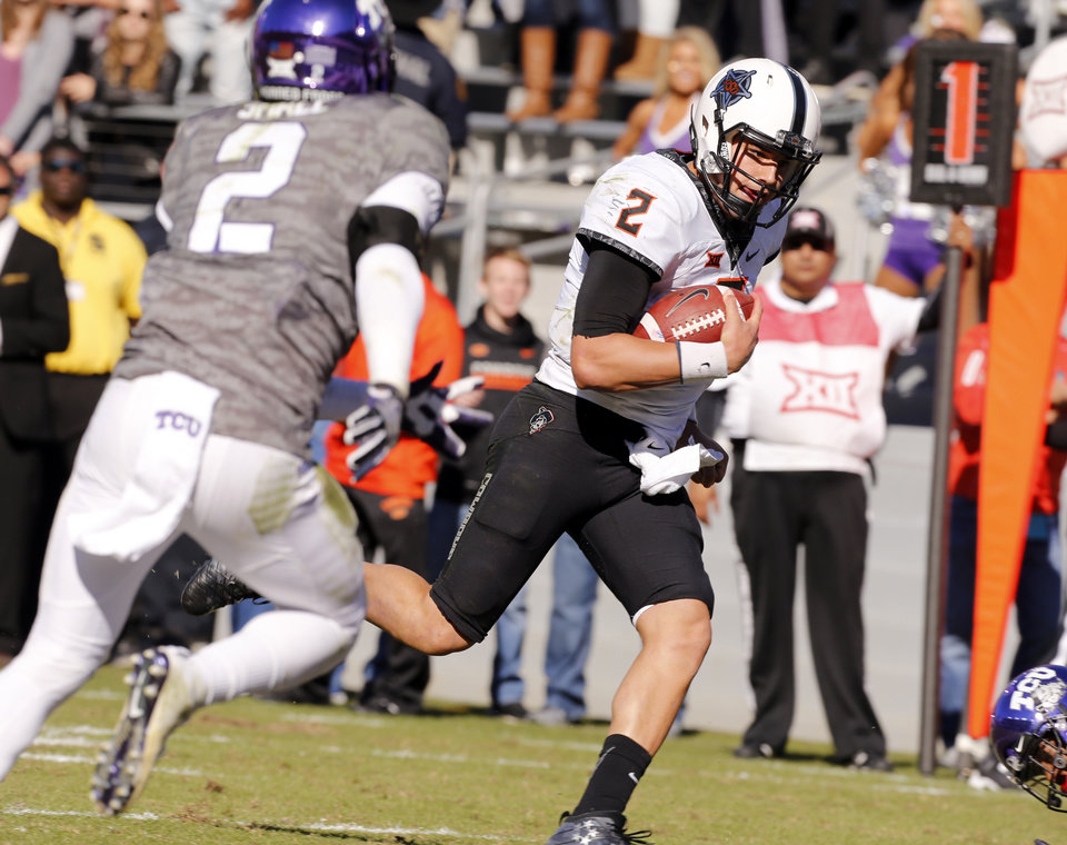 Photo - OSU's Mason Rudolph (2) heads to the end zone for a touchdown during the second half of a college football game between the Oklahoma State University Cowboys (OSU) and the TCU Horned Frogs at Amon G. Carter Stadium in Fort Worth, Texas, on Saturday, Nov. 19, 2016. Photo by Steve Sisney, The Oklahoman