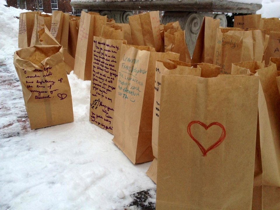 In this photo taken Sunday, Feb. 3, 2013 notes written by mourners at a memorial service for Emily Stillman, 19, a sophomore at Kalamazoo College, to and memories of Stillman are placed in paper bags that served as lanterns in Kalamazoo, Mich. They placed tealights in the bags and placed them around a bench outside the chapel. More than 60 paper lanterns surrounded the bench by the end of the memorial service. Stillman had died Feb. 3 due to complications from bacterial meningitis. (AP Photo/Kalamazoo Gazette-MLive Media Group, Emily Monacelli) ALL LOCAL TV OUT; LOCAL TV INTERNET OUT