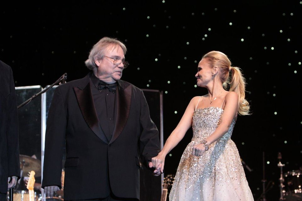 Photo - Gene Triplett and Kristin Chenoweth join hands as two of the newest inductees of the 2011 Oklahoma Music Hall of Fame. Photo by Jay Spear