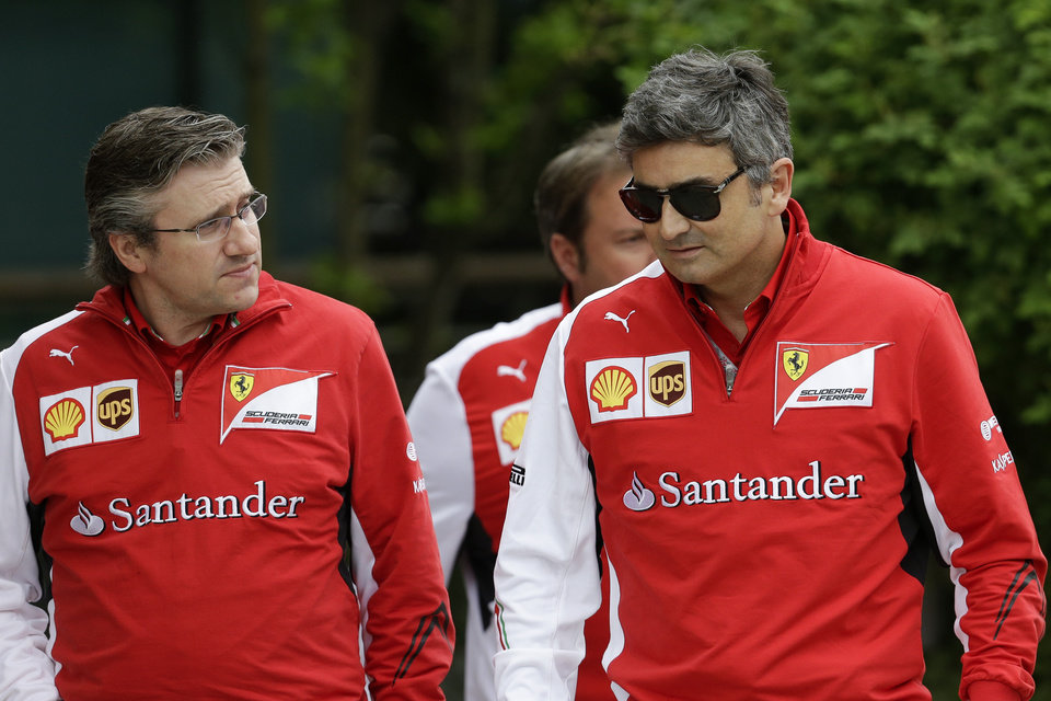 Photo - Ferrari's new team principal Marco Mattiacci, right, talks to Ferrari's director of engineering Pat Fry, left, as they walk at paddock area ahead of Sunday's Chinese Formula One Grand Prix at Shanghai International Circuit in Shanghai, China, Friday, April 18, 2014. (AP Photo/Alexander F. Yuan)