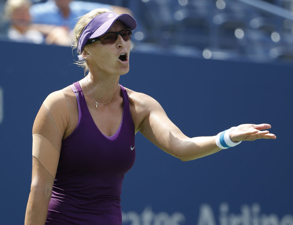 Photo - Mirjana Lucic-Baroni, of Croatia, reacts after shot against Sara Errani, of Italy, during the fourth round of the 2014 U.S. Open tennis tournament, Sunday, Aug. 31, 2014, in New York. (AP Photo/Kathy Willens)
