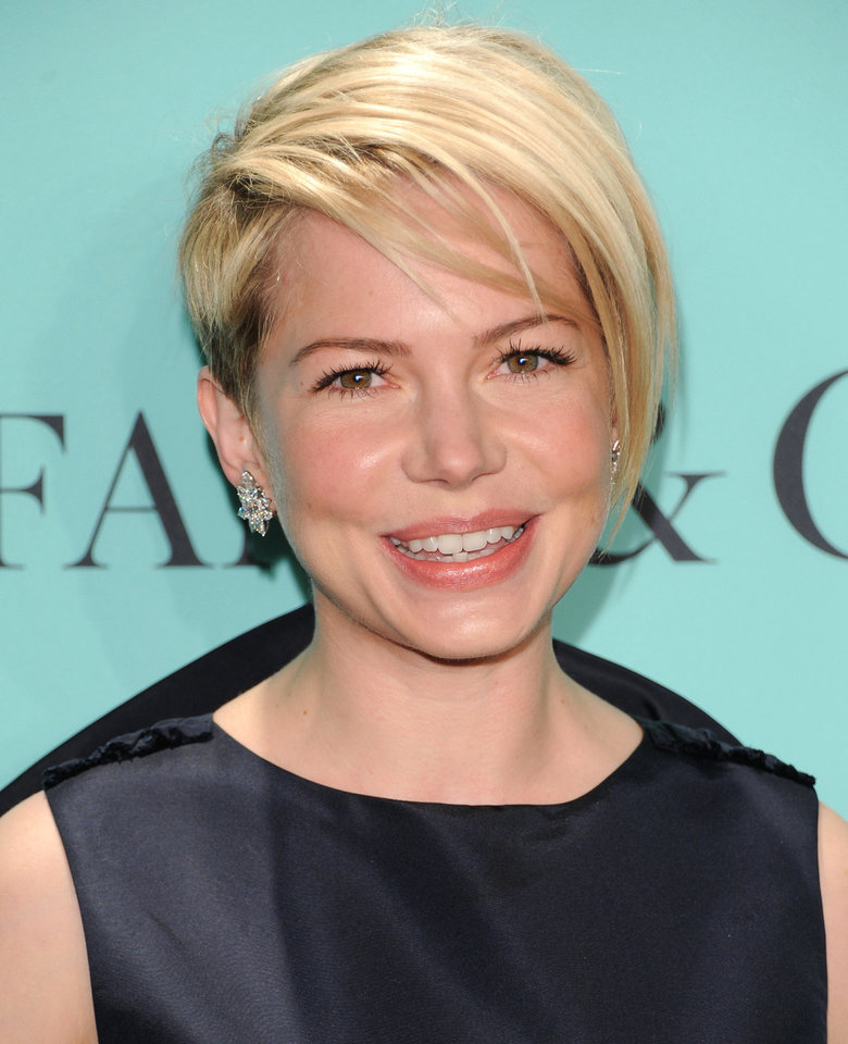 Photo - Michelle Williams has a short style that can look glamorous at a black tie event, or can be punked out for a party. AP Photo.  Evan Agostini