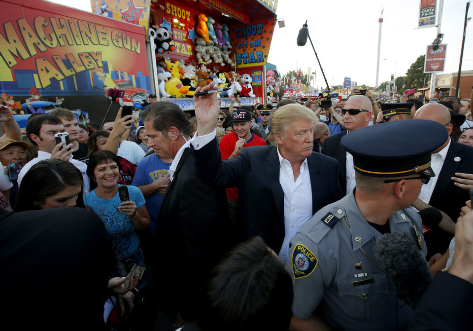 Photo - Republican presidential candidate Donald Trump walks through a crowd before a rally at the Oklahoma State Fair in Oklahoma City, Friday, September 25, 2015. Photo by Bryan Terry, The Oklahoman