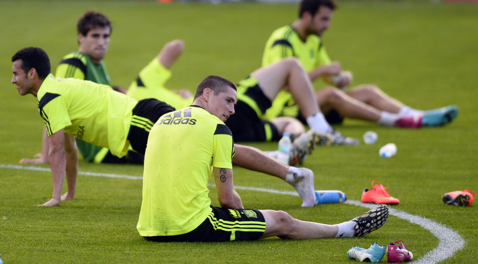 Photo - Spain's Fernando Torres, front, attends a training session with teammates at he Atletico Paranaense training center in Curitiba, Brazil, Saturday, June 14, 2014. Spain will play in group B of the Brazil 2014 World Cup. (AP Photo/Manu Fernandez)
