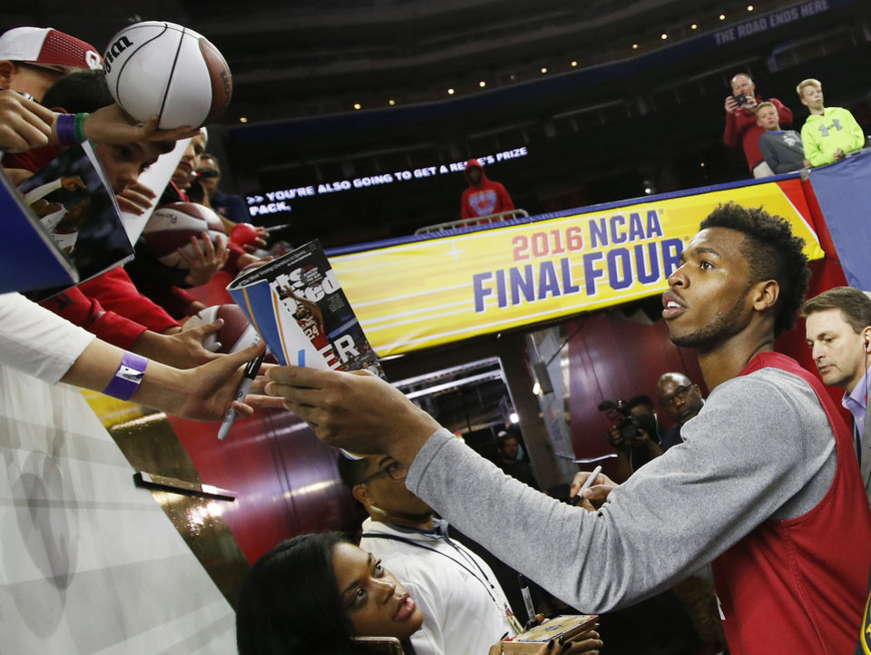 Photo - Oklahoma's Buddy Hield (24) signs autographs after practice on Final Four Friday before the national semifinal between the Oklahoma Sooners and the Villanova Wildcats in the NCAA Men's Basketball Championship at NRG Stadium in Houston, Friday, April 1, 2016. OU will play Villanova in the Final Four on Saturday. Photo by Nate Billings, The Oklahoman