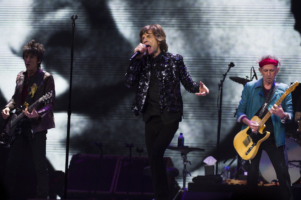 Photo - Ronnie Woods, from left, Mick Jagger and Keith Richards of The Rolling Stones perform in concert on Saturday, Dec. 8, 2012 in New York. (Photo by Charles Sykes/Invision/AP)