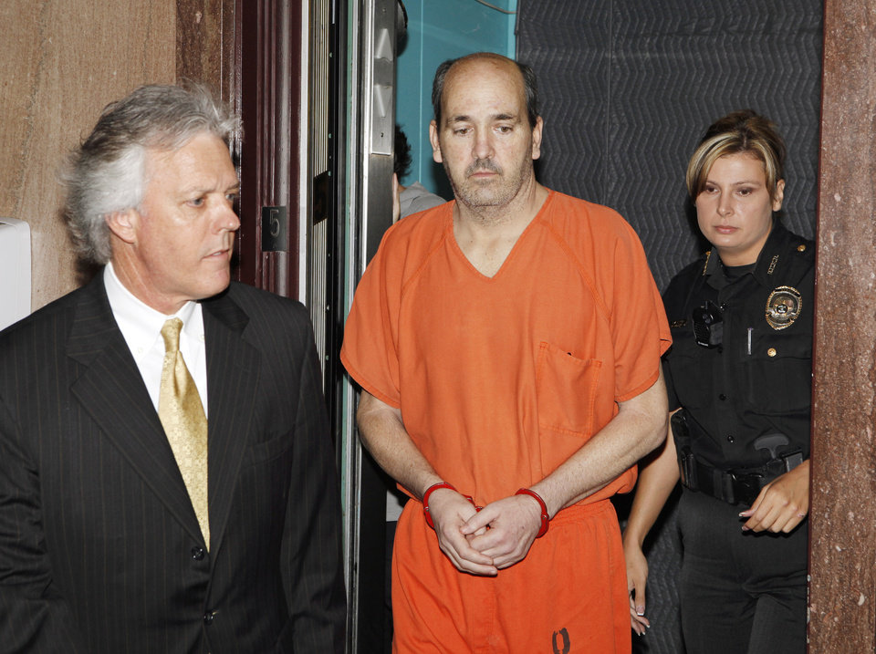 Photo - DR. STEPHEN WOLF: Attorney Mack Martin, left, escorts his client Dr. Stephen Paul Wolf from the jail elevator at the Oklahoma County Courthouse in Oklahoma City Friday, June 18, 2010.  Wolf waived his preliminary hearing before Special Judge Larry Jones in the stabbing death of his 9-year-old son. Photo by Paul B. Southerland, The Oklahoman ORG XMIT: KOD