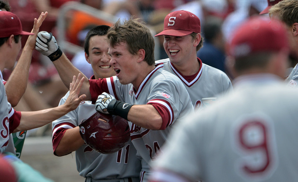 Photo - Stanford's Jack Klein, center, is congratulated by teammates after hitting a three-run home run in the sixth inning of an NCAA college regional baseball game against Indiana State, Friday, May 30, 2014, in Bloomington, Ind. (AP Photo/Tribune-Star, Joseph C. Garza)