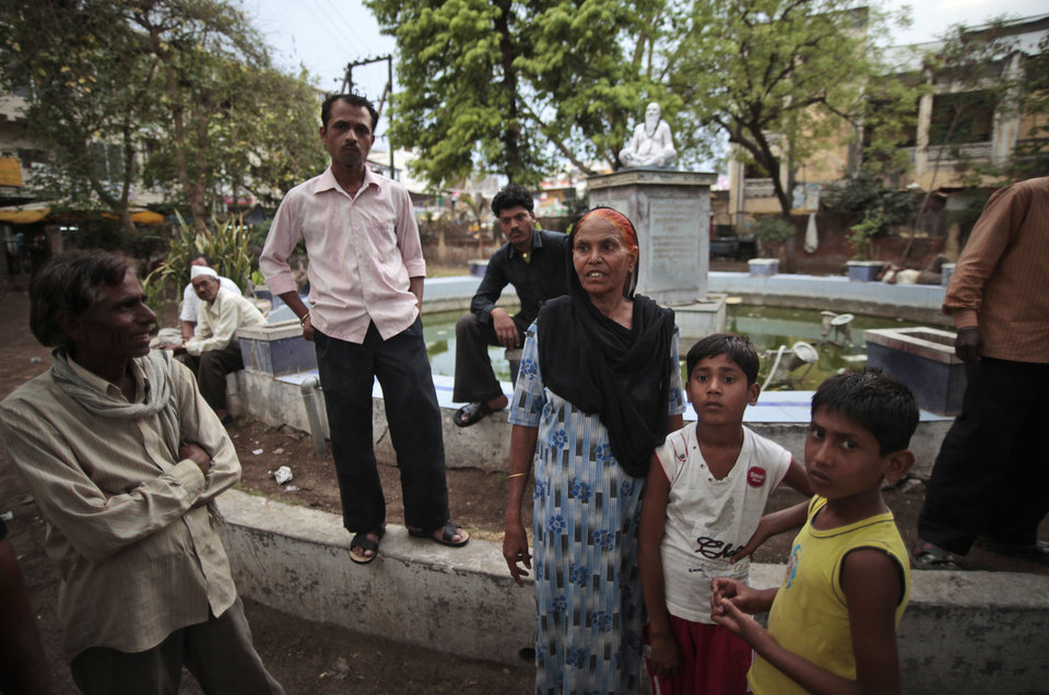 Photo -   In this May 10, 2012 photo, Fatima Munshi, center, shows the fountain in Khandwa, India where her sons Saroo and Guddu played as she worked as a daily wage laborer about 25 years ago. Living in Australia, Saroo Brierley, 30, reunited with his biological mother, Munshi, in February 2012, 25 years after an ill-fated train ride left him an orphan on the streets of Calcutta. (AP Photo/Saurabh Das)