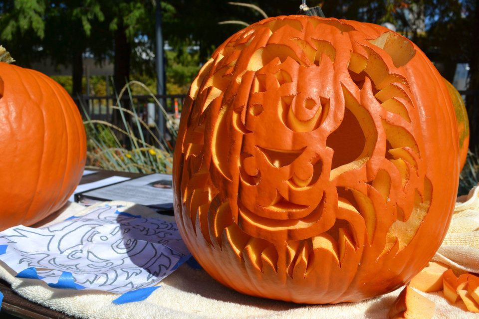 A pumpkin carved with the likeness of Oklahoma City Thunder mascot Rumble the Bison is one of several created by master pumpkin carver David Holland. Holland gave an instructional course in carving and put many of his best designs on display Saturday at Pumpkinville in downtown Oklahoma City. PHOTO BY ZEKE CAMPFIELD, THE OKLAHOMAN <strong>Zeke Campfield - Zeke Campfield</strong>