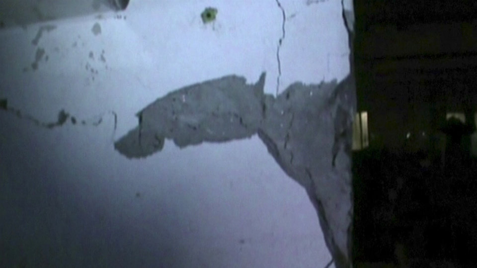 Photo - In this image made from Channel 1 video via AP video,  cracks are seen on the wall inside Rana Plaza building, as police investigated the building Tuesday, April 23, 2013,  one day before its collapse in Savar, Bangladesh.  The footage emerged on Friday, April 26,  of police in Dhaka visiting the Rana Plaza building in the city's Savar suburb to investigate cracks in its infrastructure - a day before the collapse of the structure killed hundreds of garment workers. Dhaka police say the cracks led them to order the building to be evacuated, but that the factories ignored the order.  (AP Photo/AP video) BANGLADESH OUT