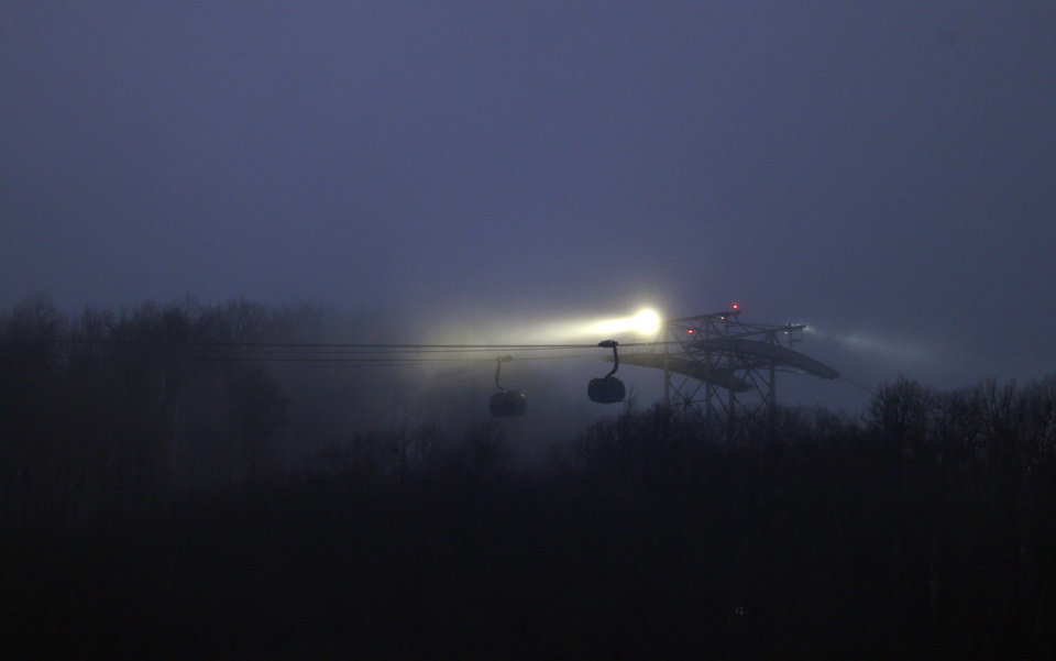 Photo - Fog rolls in over the gondola leading to the Laura Center venue and seen from the Sanki Sliding Center at the 2014 Winter Olympics, Sunday, Feb. 16, 2014, in Krasnaya Polyana, Russia. (AP Photo/Natacha Pisarenko)