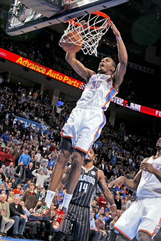 Kevin Durant (35) dunks during the opening day NBA basketball game between the Oklahoma CIty Thunder and the Orlando Magic at Chesapeake Energy Arena in Oklahoma City, Sunday, Dec. 25, 2011. Photo by Sarah Phipps, The Oklahoman