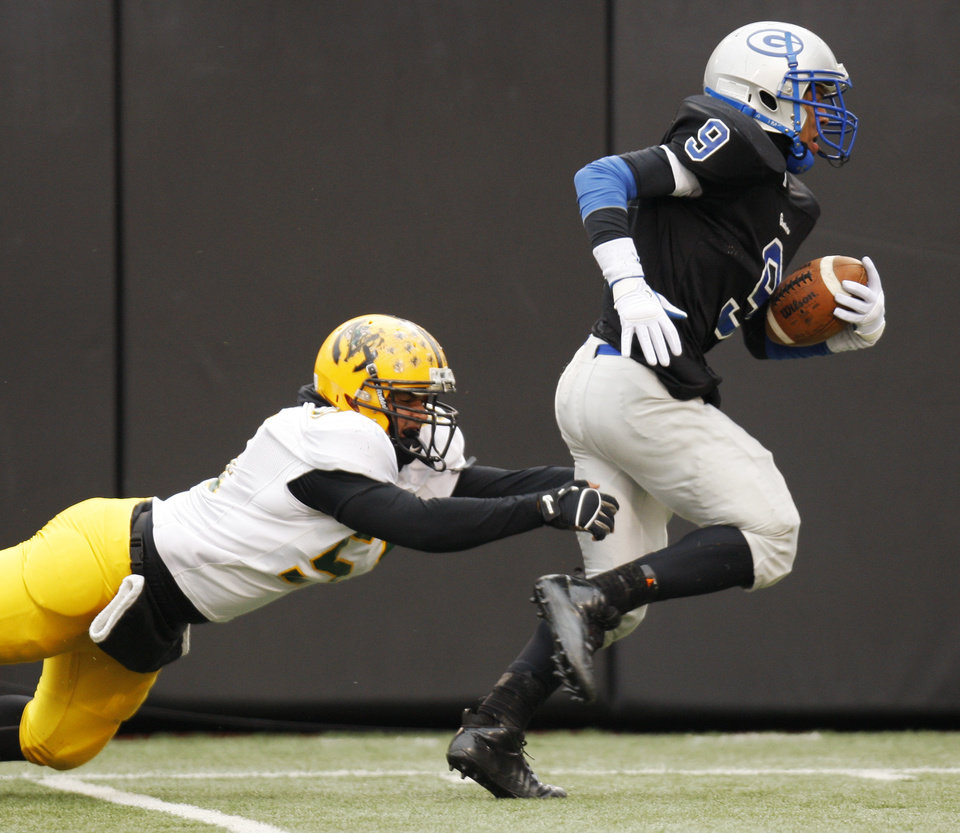 Guthrie's Kai Callins (9) breaks away from Jose Pagan (51) of Lawton MacArthur while returning an interception for a touchdown during the Class 5A high school football state championship game between Guthrie and Lawton MacArthur at Boone Pickens Stadium in Stillwater, Okla., Friday, Dec. 2, 2011. Guthrie won, 24-7. Photo by Nate Billings, The Oklahoman