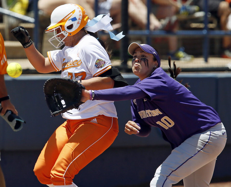 Tennessee's Cheyanne Tarango (77) makes it to first base on a single past Washington's Hooch Fagaly (10) in the fifth inning during an NCAA softball game in the Women's College World Series between Washington and Tennessee at ASA Hall of Fame Stadium in Oklahoma City, Saturday, June 1, 2013. Tennessee won 1-0. Photo by Nate Billings, The Oklahoman