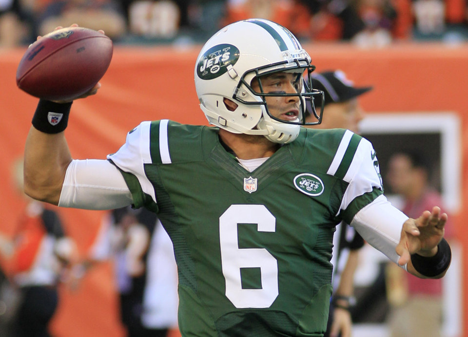 Photo -   New York Jets quarterback Mark Sanchez passes against the Cincinnati Bengals during the first half of an NFL preseason football game, Friday, Aug. 10, 2012, in Cincinnati. (AP Photo/Al Behrman)