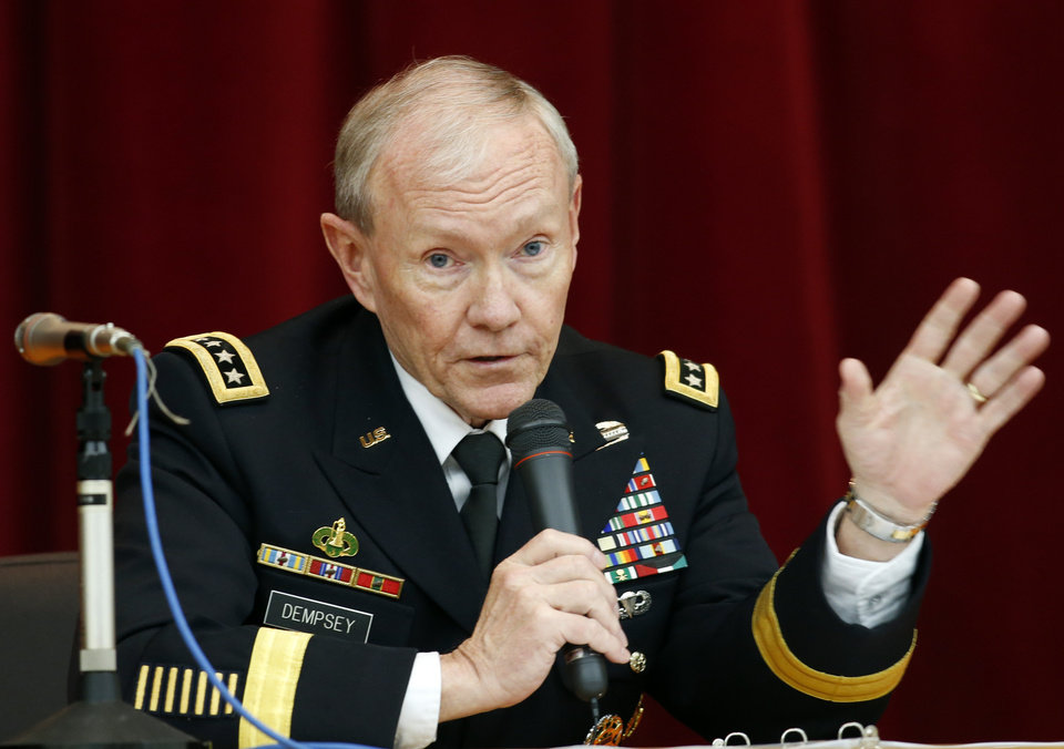 Photo - FILE - In this April 26, 2013, file photo, Chairman of the Joint Chiefs of Staff Gen. Martin Dempsey speaks during his lecture at Joint Staff College in Tokyo. One after another, the charges have tumbled out _ allegations of sexual assaults in the military that have triggered outrage, from local commanders to Capitol Hill and the Oval Office. But for the Pentagon there seem to be few clear solutions beyond improved training and possible adjustments in how the military prosecutes such crimes. Changing the culture of a male-dominated, change-resistant military that for years has tolerated sexism and sexist behavior is proving to be a challenging task. (AP Photo/Koji Sasahara, File)