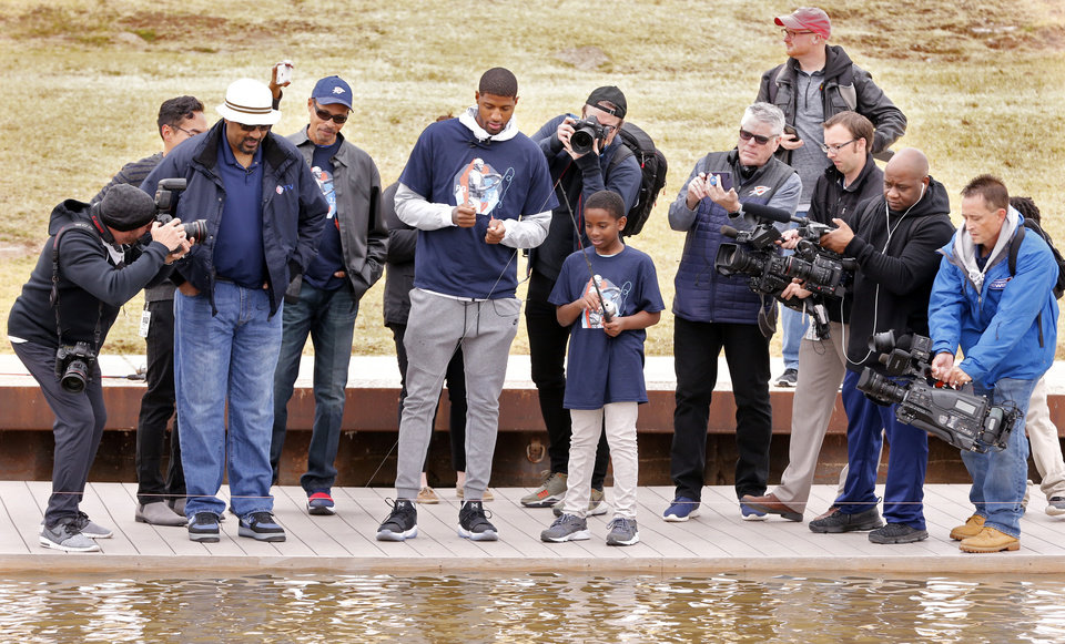 "Photo - Oklahoma City Thunder player Paul George and 45 4th-grade students from the Stanley Hupfeld Academy at Western Village practice fishing and casting at a ""PG Casting Activity"" on the Oklahoma River on Monday, Nov. 13, 2017 in Oklahoma City, Okla.  The event helped launch the Paul George Foundation outdoor initiative.  Photo by Steve Sisney, The Oklahoman"