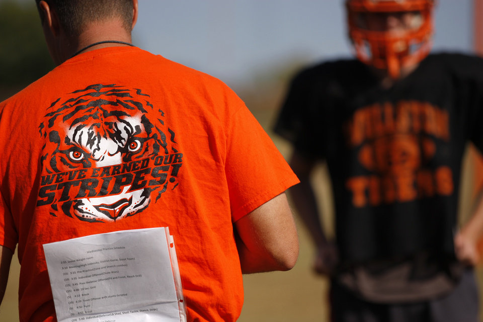 Photo - HIGH SCHOOL FOOTBALL: Wellston football coach Fred Peery watches during practice on Wednesday, October 10, 2012. Photo by Bryan Terry, The Oklahoman