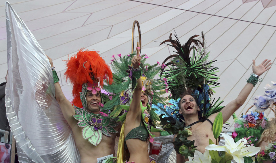 Photo - Guests in wild costumes arrive for the opening ceremony of the Life Ball in front of City Hall in Vienna, Austria, Saturday, May 31, 2014. The Life Ball is a charity gala to raise money for people living with HIV and AIDS. (AP Photo/Ronald Zak)