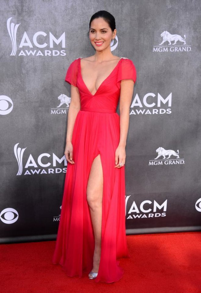 Photo -  Oklahoma City native Olivia Munn arrives at the 49th annual Academy of Country Music Awards at the MGM Grand Garden Arena on Sunday, April 6, 2014, in Las Vegas. (AP)