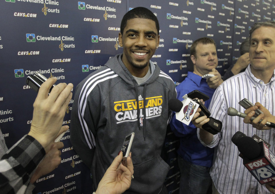 With their season ended, Cleveland Cavaliers Kyrie irving talks to the media at the team's practice facility in Independence, Ohio, on Friday, April 27, 2012. (AP Photo/Amy Sancetta)