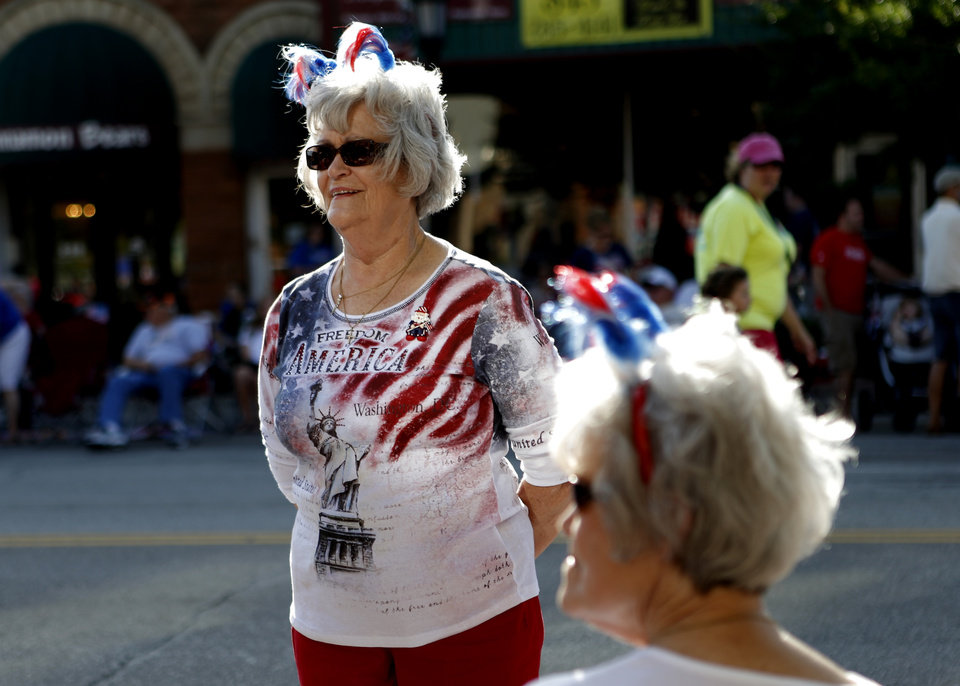 Carolyn Hassan of Warr Acres waits for the LibertyFest Fourth of July Parade to start in Edmond, Okla., Wednesday, July 4, 2012. Photo by Bryan Terry, The Oklahoman