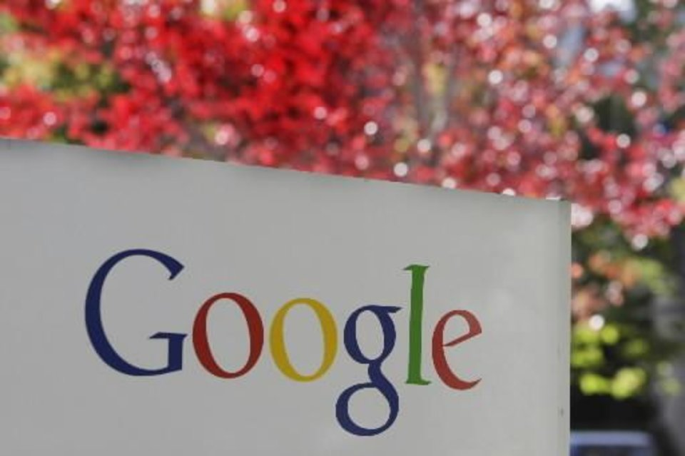 Photo - FILE - In this Nov. 10, 2010 file photo, the company logo is displayed is at Google headquarters in Mountain View, Calif. (AP Photo/Paul Sakuma, file)