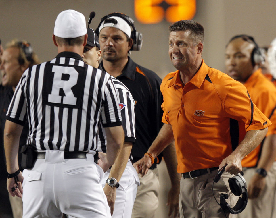 OSU head coach Mike Gundy argues a call during the college football game between the Oklahoma State University Cowboys (OSU) and the Troy University Trojans at Boone Pickens Stadium in Stillwater, Okla., Saturday, Sept. 11, 2010. Photo by Sarah Phipps, The Oklahoman