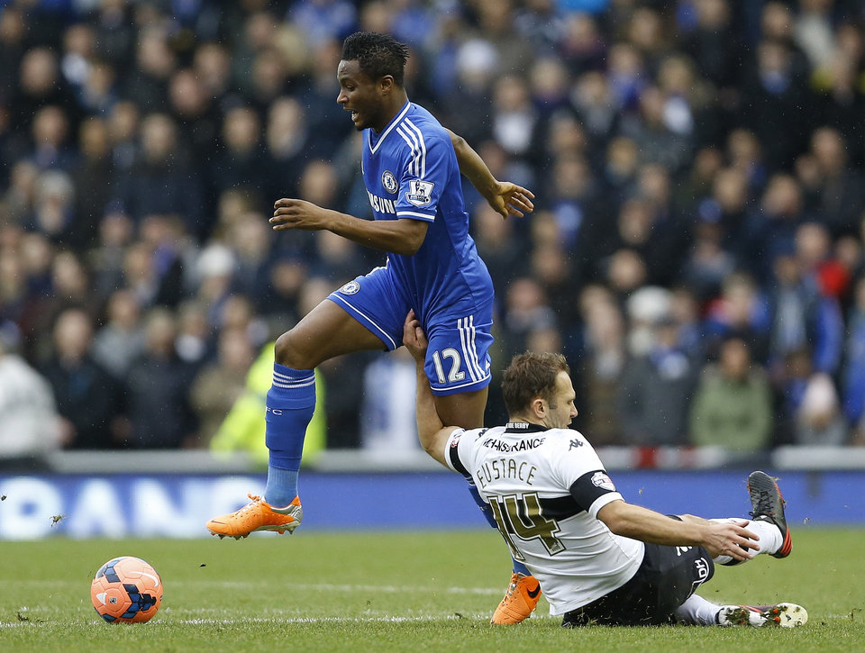 Photo - Chelsea's John Obi Mikel, left, is grabbed by Derby's John Eustace during the English FA Cup third round soccer match between Derby County and Chelsea at the iPro Stadium in Derby, England, Sunday, Jan. 5, 2014. (AP Photo/Kirsty Wigglesworth)