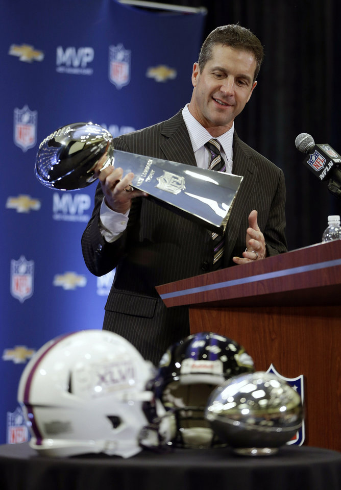Photo - Baltimore Ravens head coach John Harbaugh holds the Vince Lombardi Trophy during a news conference after NFL Super Bowl XLVII football game Monday, Feb. 4, 2013, in New Orleans. The Ravens defeated the San Francisco 49ers 34-31.(AP Photo/Darron Cummings)