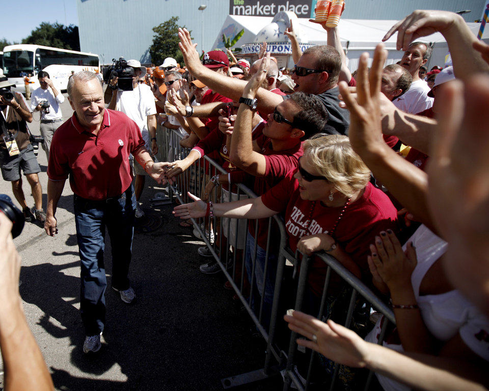 Barry Switzer greets fans before the Red River Rivalry college football game between the University of Oklahoma Sooners (OU) and the University of Texas Longhorns (UT) at the Cotton Bowl on Saturday, Oct. 2, 2010, in Dallas, Texas.   Photo by Bryan Terry, The Oklahoman