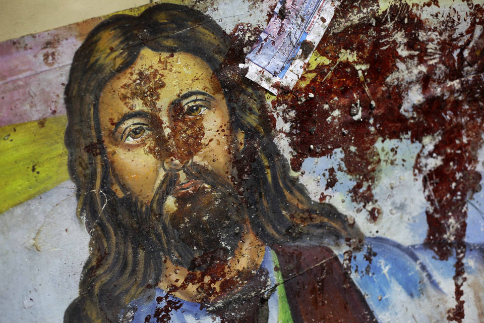Photo -   FILE - In this Saturday, Jan. 1, 2011 file photo, a blood-spattered poster of Jesus Christ is seen inside the the Coptic Christian Saints Church in the Mediterranean port city of Alexandria, Egypt, which killed some 21 people. Despite his rhetoric and promises to uphold the civil nature of Egypt, Shafiq seemed to some Egyptians an odd choice for Christians who suffered attacks under Mubarak's near 30 year-rule, culminating in the bombing of a church in Alexandria that killed 21 people attending a New Year's Even Mass more than a year ago. (AP Photo/Ben Curtis, File)