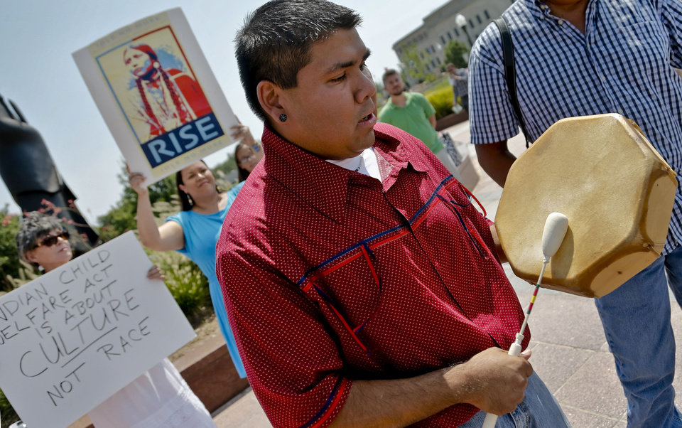 Photo - Chebon Kernell, of the United Methodist Church, performs an American Indian song during a rally at the Capitol for Baby Veronica's father, Dusten Brown. PHOTO BY CHRIS LANDSBERGER, THE OKLAHOMAN  CHRIS LANDSBERGER