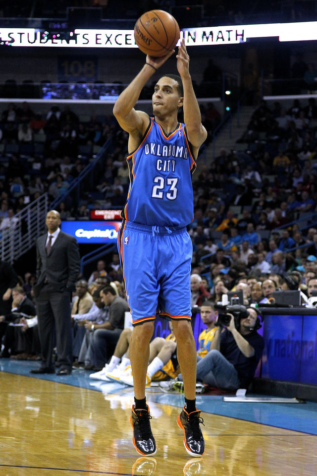 Oklahoma City guard Kevin Martin (23) shoots the ball during the first half of an NBA basketball game against the New Orleans Hornets in New Orleans, Friday, Nov. 16, 2012. (AP Photo/Jonathan Bachman) ORG XMIT: LAJB104