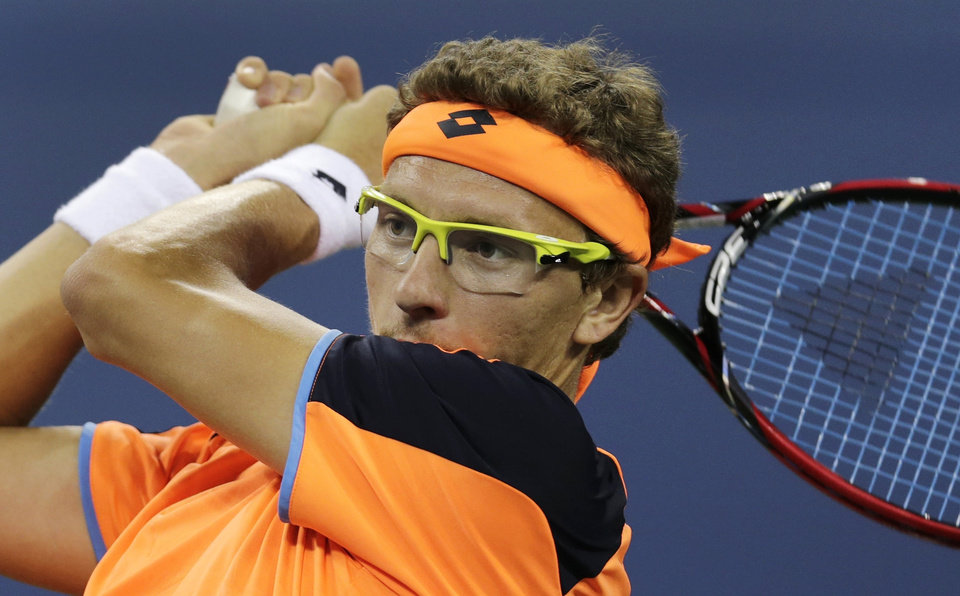 Denis Istomin, of Uzbekistan, watches a return to Andy Murray, of Britain, during the fourth round of the U.S. Open tennis tournament, Tuesday, Sept. 3, 2013, in New York. (AP Photo/Charles Krupa)