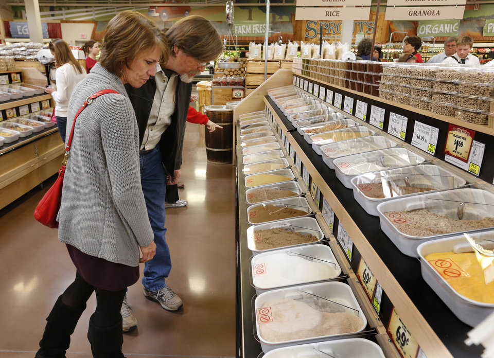 Teresa and Tom Dotson look over bulk food items at a preview party Tuesday at the new Sprouts Farmers Market in Norman. PHOTO BY STEVE SISNEY, THE OKLAHOMAN