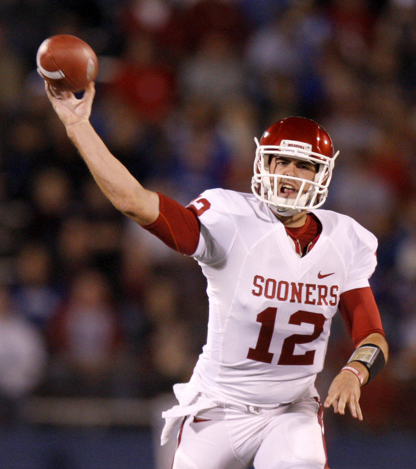 Photo - Oklahoma's Landry Jones (12) throws a pass during the college football game between the University of Oklahoma Sooners (OU) and the University of Kansas Jayhawks (KU) at Memorial Stadium in Lawrence, Kansas, Saturday, Oct. 15, 2011. Photo by Bryan Terry, The Oklahoman