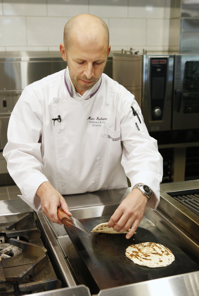 Photo - Chef Marc Dunham cooks tortillas on a griddle at Francis Tuttle Technology Center in Oklahoma City. Photo by Paul B. Southerland, The Oklahoman  PAUL B. SOUTHERLAND