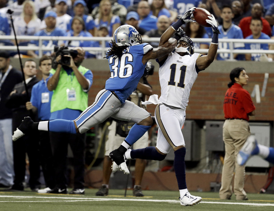 Photo -   St. Louis Rams wide receiver Brandon Gibson (11) catches a 23-yard touchdown reception as Detroit Lions cornerback Jonte Green (36) defends in the fourth quarter of an NFL football game in Detroit, Sunday, Sept. 9, 2012. Detroit won 27-23. (AP Photo/Paul Sancya)