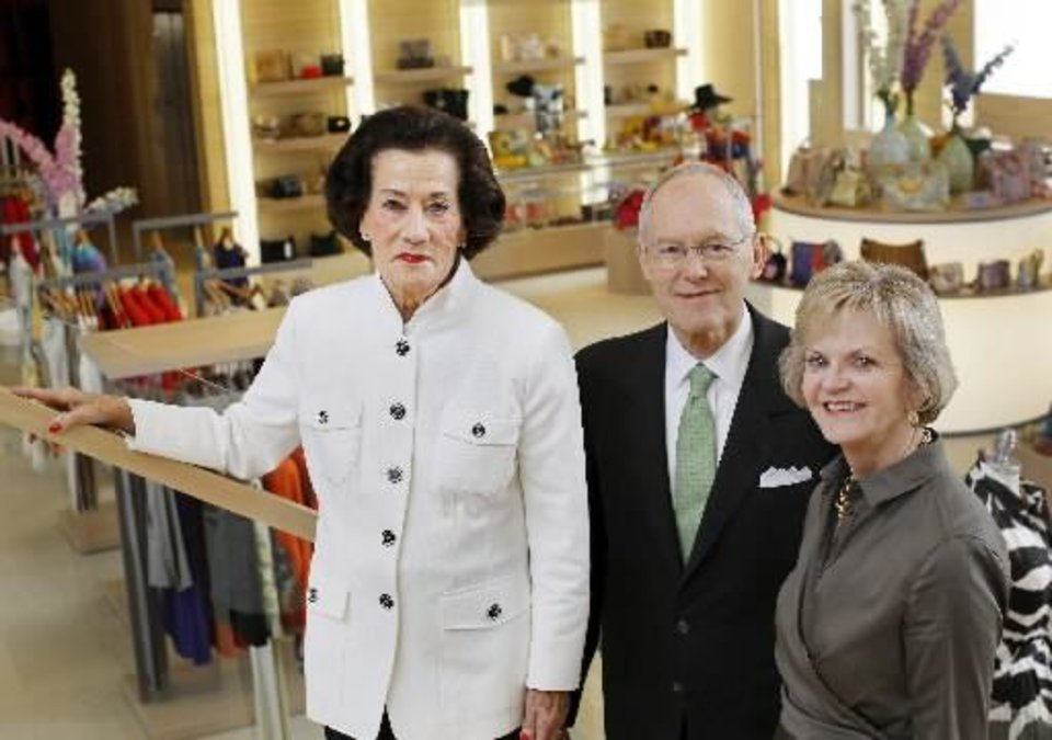 Lolly with Bob and DeDe Benham, owners of Balliet's.  Bob Benham had this to say about Lolly: �Lolly is a beautiful, elegant woman who has seen Balliets evolve from its origin downtown, under Edna Balliet, to the current location at Classen Curve. A lady in the best sense of the word, her impeccable sense of fashion has inspired loyalty from three generations of customers. We treasure her presence every day.� (Photo by Jim Beckel).