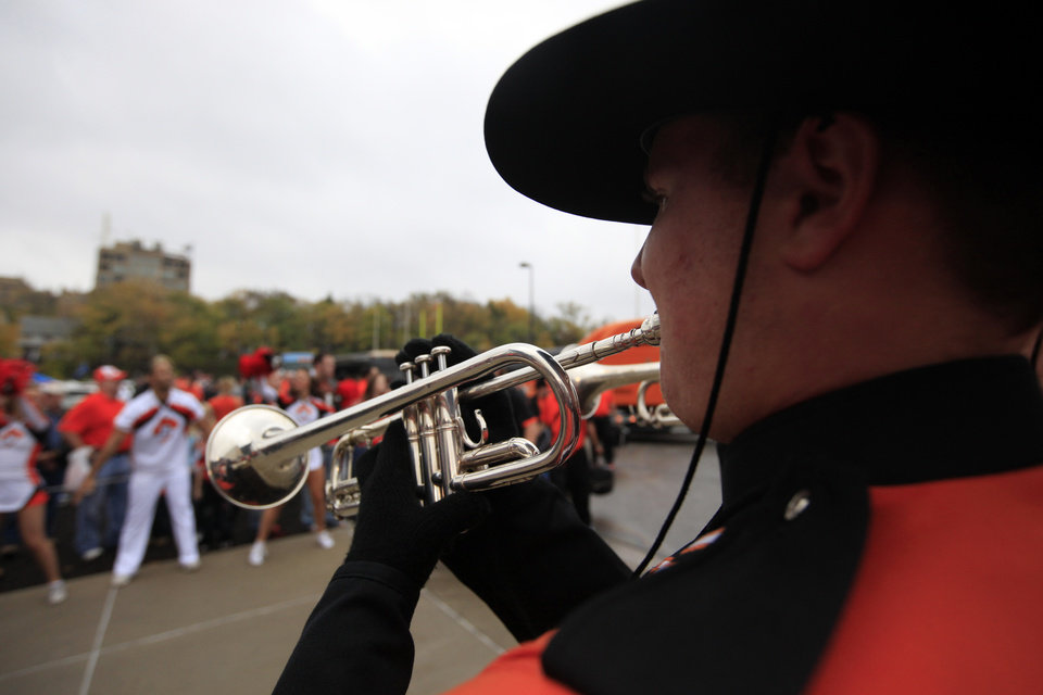 An OSU band member plays during the walk during the college football game between Oklahoma State University (OSU) and the University of Kansas (KU) at Memorial Stadium in Lawrence, Kan., Friday, Oct. 12, 2012. Photo by Sarah Phipps, The Oklahoman