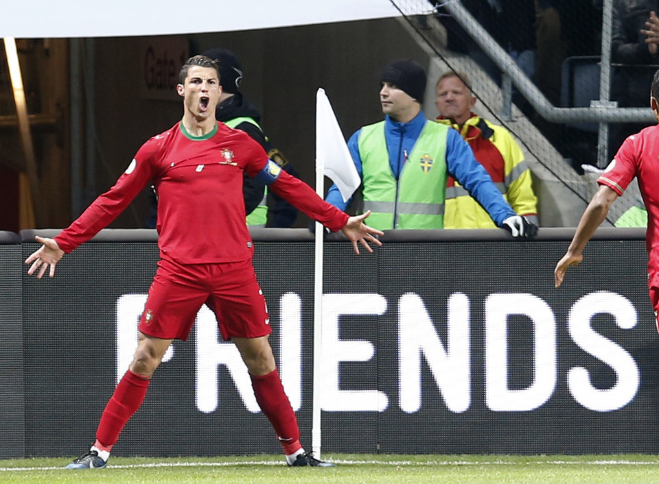 Photo - Portugal's Cristiano Ronaldo celebrates scoring the opening goal during the World Cup qualifying playoff second leg soccer match between Sweden and Portugal in Stockholm, Sweden, Tuesday, Nov.19, 2013. (AP Photo/Frank Augstein)