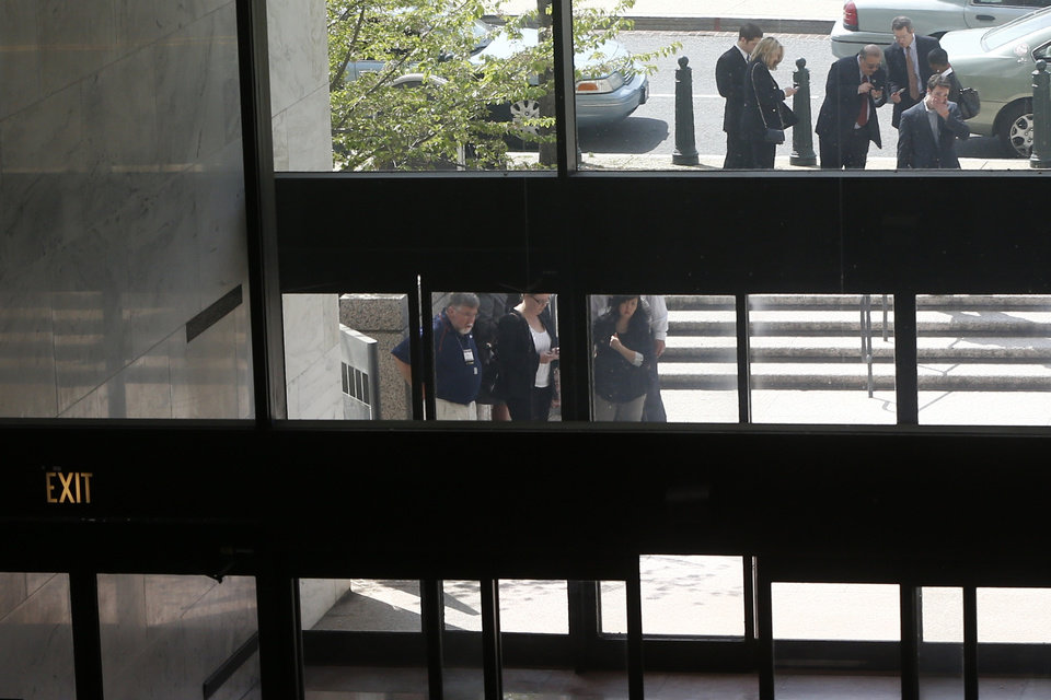 Photo - People are seen outside the Hart Senate Office Building on Capitol Hill in Washington, Wednesday, April 17, 2013, after being evacuated following reports of suspicious packages discovered on Capitol Hill. Capitol police are investigating the discovery of at least two suspicious envelopes in Senate office buildings across the street from the Capitol. (AP Photo/Charles Dharapak)