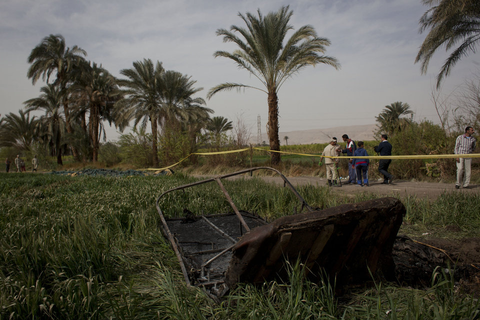 Damaged remains of the hot air balloon are seen at the site of the accident, in Luxor, Egypt, Tuesday, Feb. 26, 2013. A hot air balloon flying over Egypt's ancient city of Luxor caught fire and crashed into a sugar cane field on Tuesday, killing at least 19 foreign tourists in one of the world's deadliest ballooning accidents and handing a new blow to Egypt's ailing tourism industry. (AP Photo/Nasser Nasser)