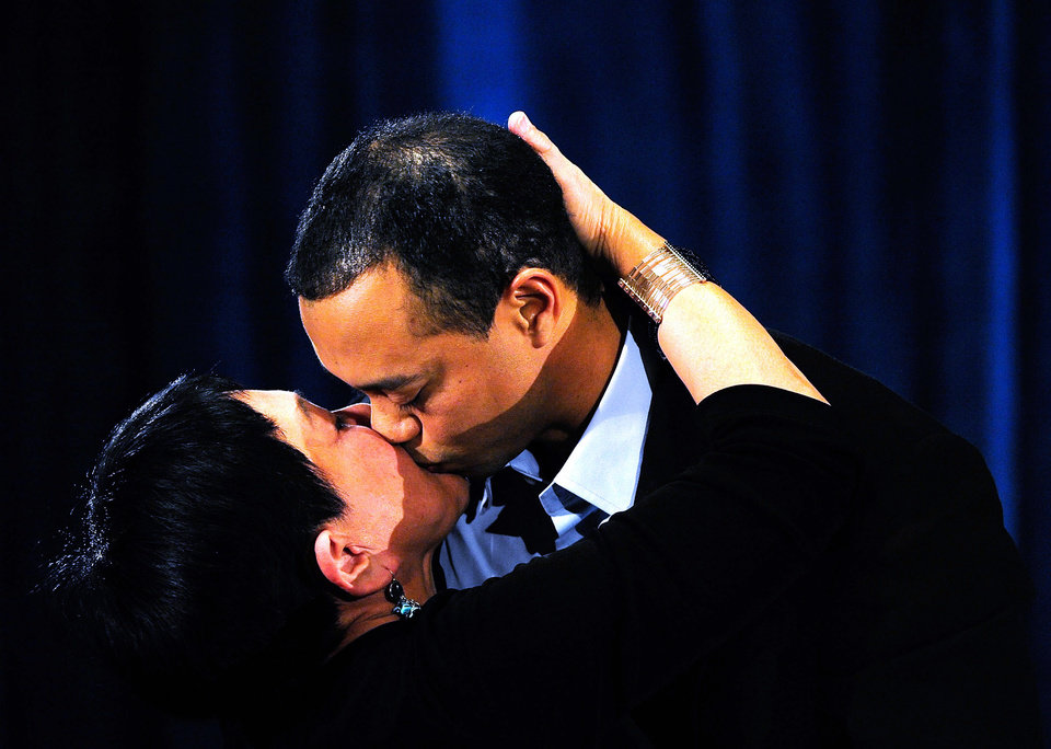Photo - Tiger Woods kisses his mother Kultida Woods after making a statement at the Sawgrass Players Club, Friday, Feb. 19, 2010, in Ponte Vedra Beach, Fla. (AP Photo/Sam Greenwood, Pool) ORG XMIT: TWP115