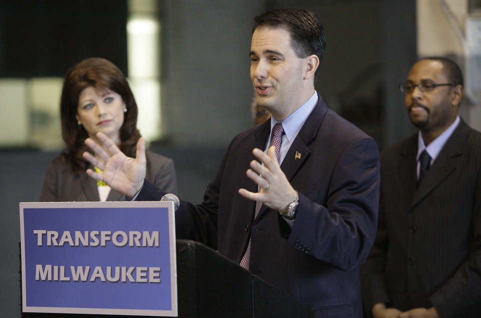 Photo -   Gov. Scott Walker makes a Milwaukee economic development announcement at the Hatco Corporation Storage Warehouse on South 28th Street in Milwaukee on Monday, April 30, 2012. Joining the governor are Lt. Gov. Rebecca Kleefisch and Workforce Development Director Reggie Newson. Walker announced the $100 million