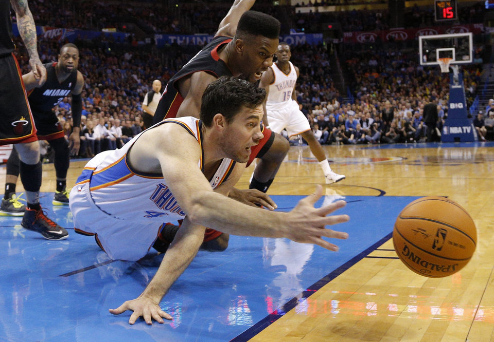Photo - Oklahoma City's Nick Collison (4) dives for the ball in front of Miami's Norris Cole (30) during an NBA basketball game between the Oklahoma City Thunder and the Miami Heat at Chesapeake Energy Arena in Oklahoma City, Thursday, Feb. 20, 2014. Photo by Bryan Terry, The Oklahoman